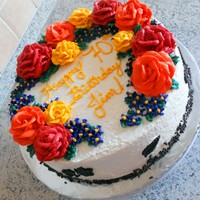 Autumn Colored Floral Birthday Cake All done in buttercream except for dark chocolate molded leaves. Cake is made with Splenda since client is diabetic. The white icing had a...