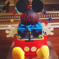 Mickey Mouse Cake Mickey Mouse cake! feet are made of rice krispies covered in fondant. ears and hands are made of gum paste. Inside is a vanilla cake with...