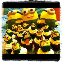 Minion Cupcakes Minion Cupcakes from the movie Despicable Me. The two minions with hearts in the middle represent the clients. It was a boyfriends surprise...