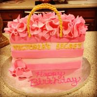 Victoria's Secret Bag Cake * Red Velvet with Cream Cheese frosting. Tissue paper made of fondant, handles made of gumpaste and Victoria's Secret letters made of...