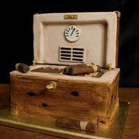 Humidor Cake *Chocolate Cake with Chocolate Buttercream. Wood Grain was hand painted with food coloring. Cigars are rolled in fondant and dusted brown...