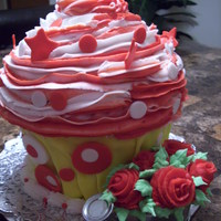 Giant Cupcake Birthday cake for a friend who loves cupcakes and decorates our office with flowers. Dark chocolate pound cake with buttercream and fondant...