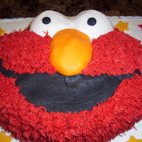 Elmo Elmo cake with buttercream and fondant accents