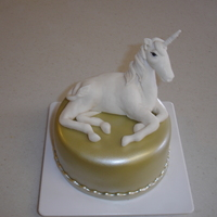 Unicorn Birthday Cake This unicorn was made from a great vlog. It's on a 6 inch tier that is airbrushed with gold, then pearl sheen.