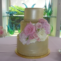 Gold Wedding Cake Gold wedding cake with live flowers.