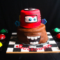 Cars Themed Cake With Side Cupcakes Cars themed cake (bulging on the side I know :/) and Minion, Spiderman and Ben 10 Cupcakes on the side. The cake is chocolate cake with...