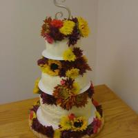 My 1St Wedding Cake Fall Wedding cake-- bottom cake was Carrot Cake w/Orange cream cheese icing, middle cake was Lemon Cake with Lemon Cream cheese icing, and...