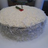 Coconut Christmas Holly Cake Coconut cake made to look like snow.