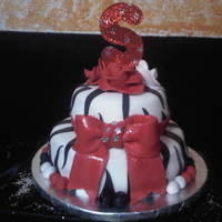 Made For A Friends Birthday red velvet cake covered with butter cream and fondant....zebra print
