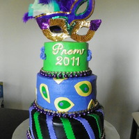 Mardi Gras Prom Cake A cake I did for the local prom! Bottom tier is covered in fondant, top 2 tiers were BC. Mask is made out of cardboard, and beads around...