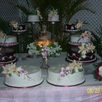 Elegant Burgundy And Ivory Wedding Cake   ten elegant tiers arranged in a circle with fountain in the centre