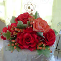 Roses Are Red And Orange   sugar roses and berries cake top