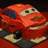 Lightning Mcqueen   Lightning McQueen of Cars. Molded on Witon race car cake and made of Italian Buttercream