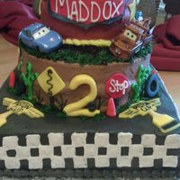 Lightning Mcqueen Cars cake chocolate cake with oreo filling.