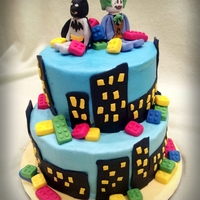 "Batman Lego Cake 6"" and 8"" round vanilla with bavarian cream filling. Buttercream icing with fondant decorations. Batman and Joker are made from..."