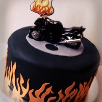 "Motorycycle Madness 6th Birthday cake for a boy that loves motorcycles! 8"" round chocolate chip cake with ganache filling and icing. Covered in fondant..."