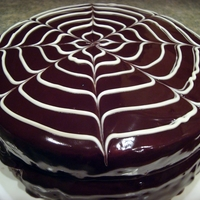 Spiderweb Ganache Dark chocolate cake with chocolate buttercream filling. Poured ganache icing.