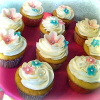Bridal Shower   Malibu flavored cupcakes with whipped malibu icing. Flowers are made from white modeling chocolate.