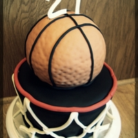 "Basketball Hoop 10"", 9"", 8"" basket was white chocolate cake with caramel filling. Basketball tier was cookies n' cream. All covered in..."