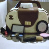 First Purse Cake Only Make Up Handle And Front Flap Are Fondant The White Cap Under The Handle Is Temporary Only To Hold Handle Up Til First purse cake. Only make-up, handle and front flap are fondant. The white cap under the handle is temporary, only to hold handle up till...