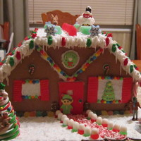 My First Gingerbread House. It took me 6 days. I loved decoratiang it, but assembling the house itself drove me crazy! Like they say, practice makes perfect! LOL...