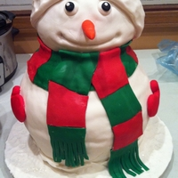"3D Snowman Christmas Cake I hand carved the snowman out of round cake layers and covered in fondant. I made sure the fondant wasn't ""wedding cake""..."