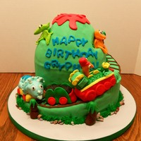 Dinosaur Train This is a Dinosaur Train cake for a 3rd birthday. The train is RKT and all the figures are fondant.
