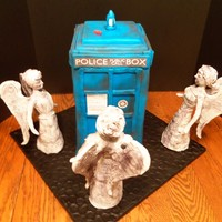 "Don't Blink This cake is the TARDIS and Weeping Angels from Doctor Who. The cake is 6 layers of 6"" squares covered in fondant. The Angels are..."