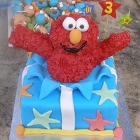 Elmo For Jonno! This is my first ever decorated cake. I made it for my son's 3rd birthday. the cake is chocolate mud with chocolate ganache and...