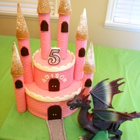Castle Cake With Dragon Castle Cake with Dragon. The cake is red velvet and the dragon is a toy.