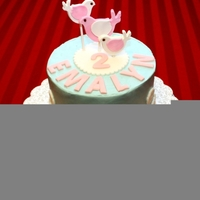 Elegant Birds Baroque Cake Deluxe chocolate cake inside with buttercream icing that was tinted light blue. The birds are gum paste and the baroque embellishments are...