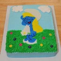 A Smurfette Birthday Vanilla cake with vanilla buttercream. Smurfette and the fowers are made of fondant. The custoemr loved it! TFL