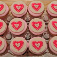Sweetheart Cupcakes These are white cake with strawberry filling and strawberry buttercream. The toppers are made of gumpaste and fondant with buttercream and...
