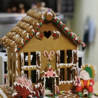 This Gingerbread House Was About 18H X 14W The Sleigh And The Chair Was Made Of Pastillage And The Santa Was Made Of Gum Paste There Is A This gingerbread house was about 18h X 14w. The sleigh and the chair was made of pastillage and the Santa was made of gum paste. There is a...