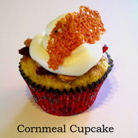 Cornmeal Cupcake With Cream Cheese Honey cornmeal cake with roasted sweet redpeppers, honey cashews, cream cheese icing, and cheddar lace