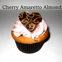 Cherry Amaretto Cupcake Dark sweet cherries soaked in amaretto liquor in an almond poppy seed cake with cherry buttercream