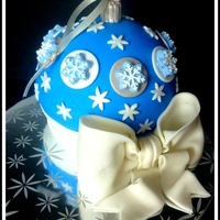 """snowflake Ornament"" Christmas ornament cake with snowflake details."