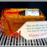 """wine Crate"" Cake Wine bottle is made of dark mint chocolate with fondant and sugar sheet details. The crate is cake with fondant details and white chocolate..."