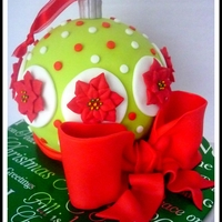"""poinsetta Ornament"" Ornament cake with read and green details with Poinsettias."