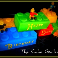Lego Cake Lego cake with fondant Lego men. Yellow cake with vanilla butter cream icing.