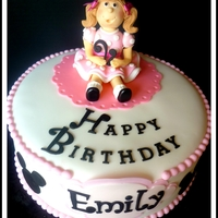 Minnie Mouse Cake Strawberry cake with cream cheese icing. Fondant figure with fondant details.