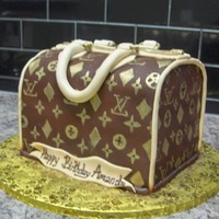 Lv Bag  All fondant...Disappointed with the zipper mold I purchased..Kinda small but still worked..Fondant sagged a bit but it kind of looks like a...