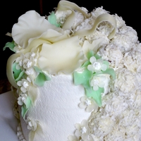 Mature Love  banana mousse torte covered with whipped cream and bana truffles covered with coconut shavings. The flowers are made with white modeling...