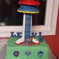 Paw Patrol Birthday Cake  Wow this cake was a first and you can tell lol! First time messing with Rice Krispies. That is what I made the tower from. Great learning...