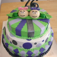 Two Peas In A Pod   for twins 76th birthday, buttercream with fondant accents. topper faces are molded chocolate and fondant. TFL