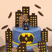Batman Gotham City Guardian Buttercream iced with fondant accents (buildings, logo, bats and birthday lettering). The Batman itself is a candle. Had an edible image...