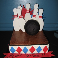 Bowling Birthday Fondant accents and a 2 layered sheet cake with a fondant, wood grained & hand painted bowling alley floor.