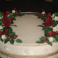 Grooms Cake Oval Shaped Cake with Red Roses and Cream Blossoms with gold borders