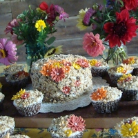Fancy Carrot Cake Carrot cake and cupcakes with fondant flowers. These were made for our anual neighbor's picnic.