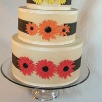 "Fall Wedding 10"", 8"", 6"" rounds covered in fondant. Fondant flowers"